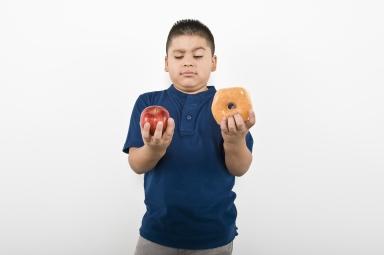 bigstock-Young-boy-choosing-between-an--41894737